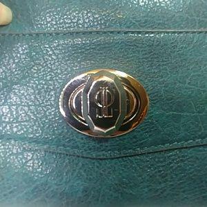 Jennifer Lopez Bags - J Lo, vegan leather wristlet, silver spin lock